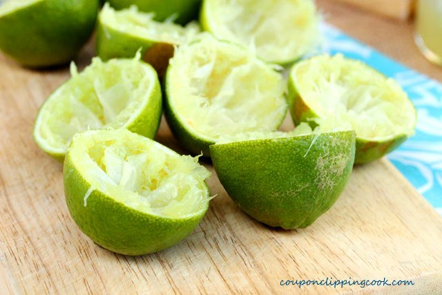 Juiced limes on cutting board