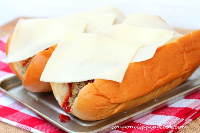 Add slices of cheese on meatball sandwich