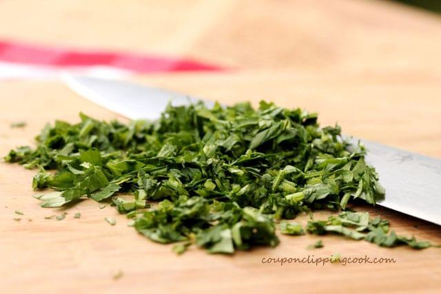 Chopped parsley on cutting board