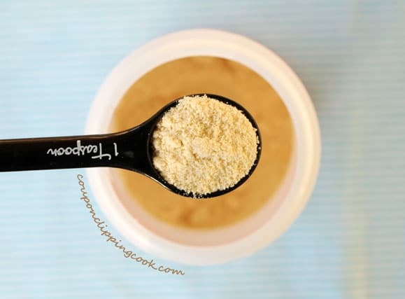 Malted milk powder in measuring spoon