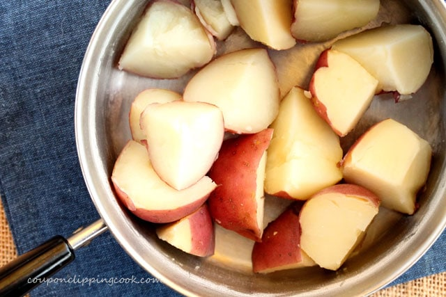 Cooked red potatoes in pot