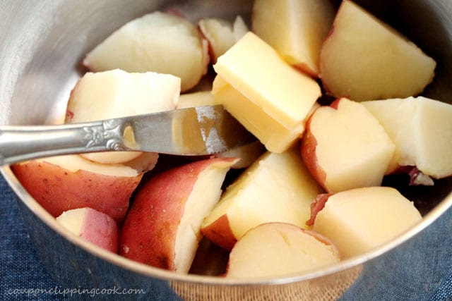 Add butter in pot with potatoes