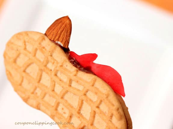 Nutter Butter cookie with red fruit roll and almond