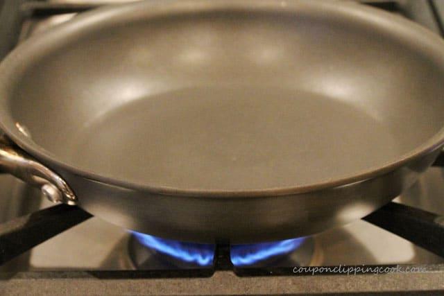 Heat skillet on burner on stove top