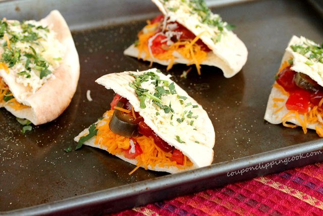 Cheesy Pita Quesadillas with Nacho Jalapenos on sheet pan