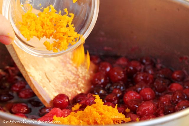 Add orange zest to pot