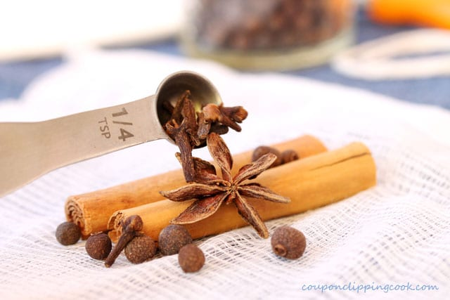 Add whole cloves to star anise