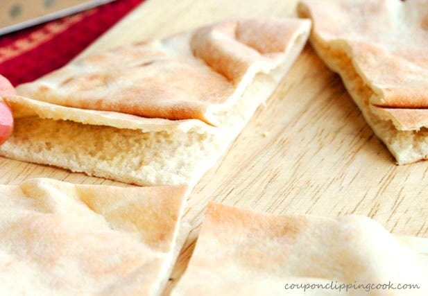 Open quarter of pita pocket bread on cutting board