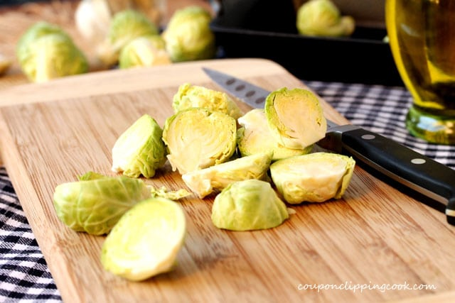 Cut Brussels sprouts in half on board