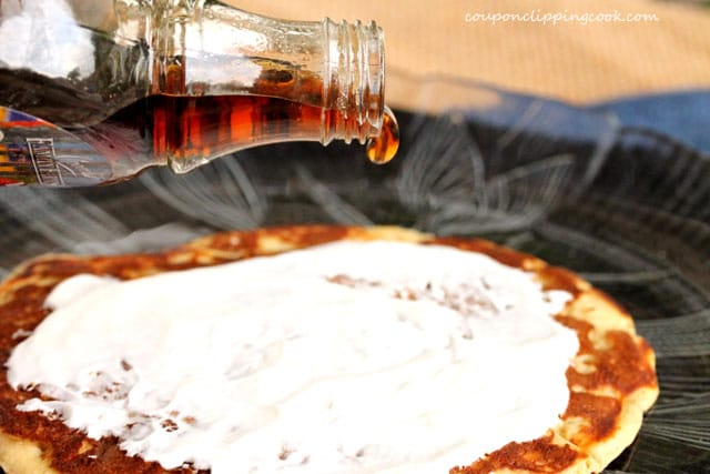 Pour syrup on pancake on plate