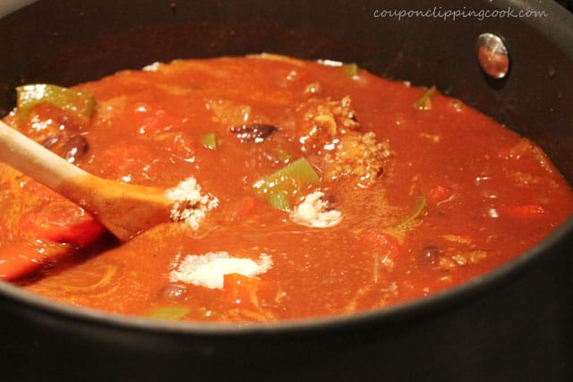 Stir chili in pot with wooden spoon