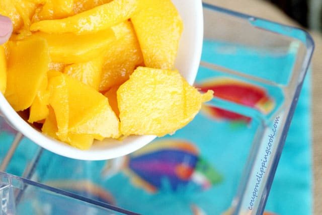 Add mango to blender for smoothie