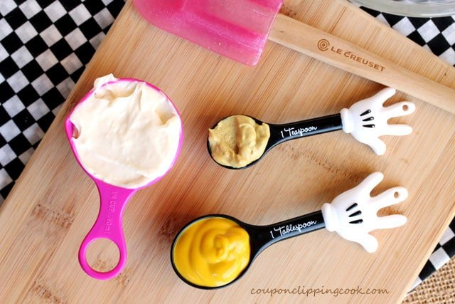 Mustarn and mayonnaise in measuring spoons