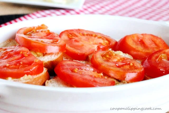 Sliced tomatoes on top of garlic French bread
