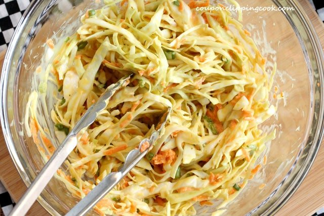 Coleslaw in bowl with tongs
