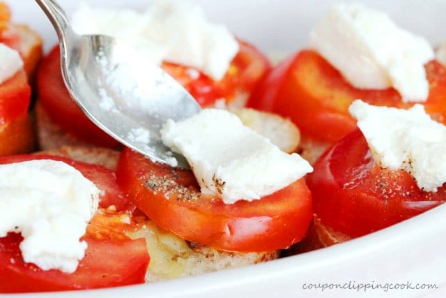 Add ricotta cheese on top of tomato slices