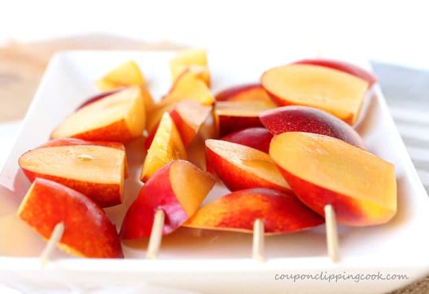 Nectarines on skewers on plate