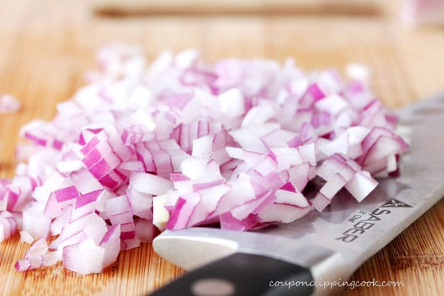 Chopped red onions on cutting board