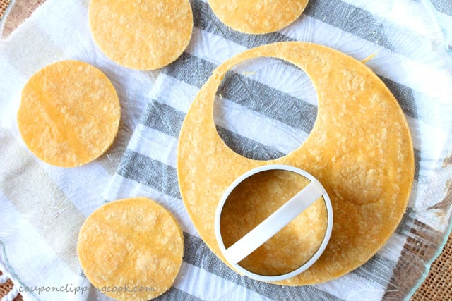 Cut corn tortillas into small rounds