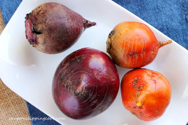 Red and orange beets on plate