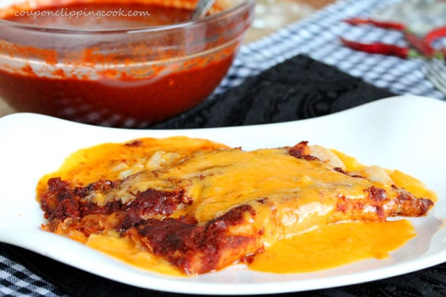 Cheesy enchiladas on plate
