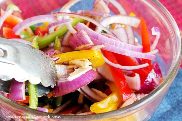 Mix vegetables in fajita sauce in bowl