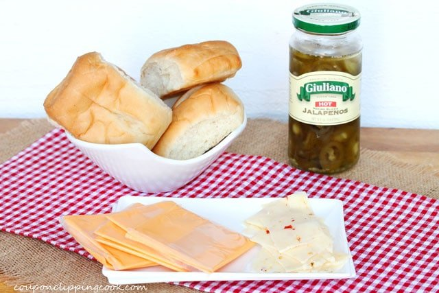 Bread rolls, cheese slices and jar of jalapenos