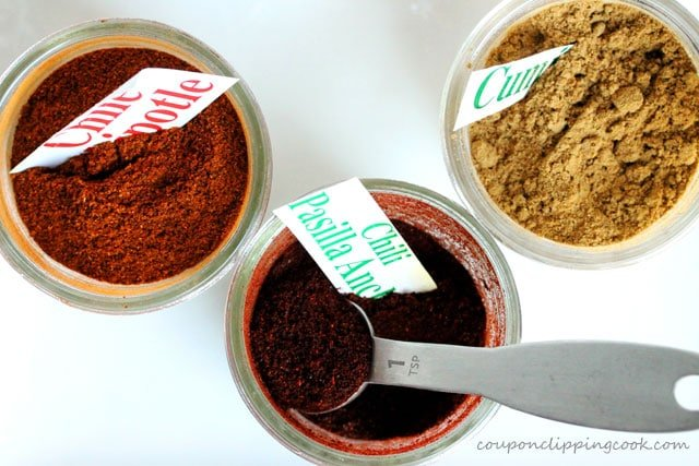 Chili powder and ground cumin in jars
