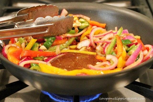 Saute vegetables in skillet