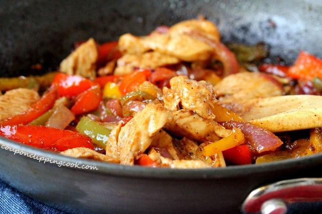 Chicken and vegetables in fajita sauce in pan