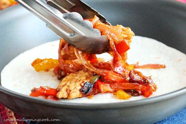 Add chicken and vegetable fajitas on tortilla