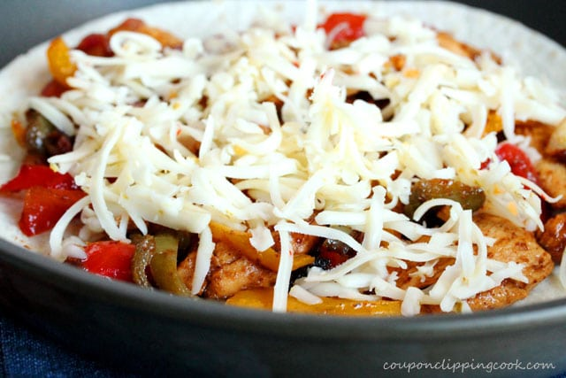 Top chicken fajitas and vegetables with cheese
