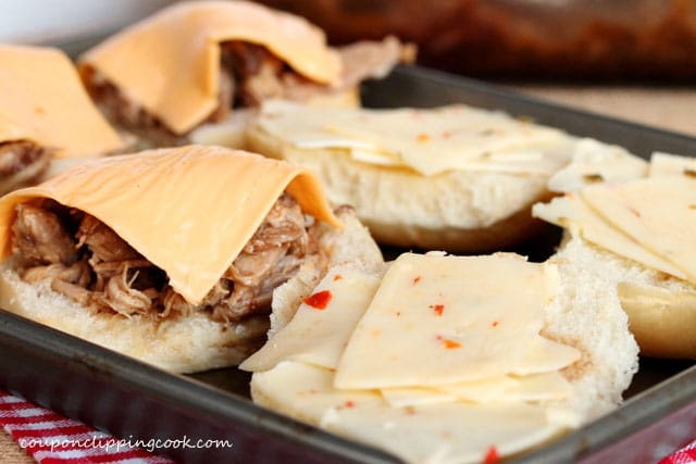 Top pulled pork sandwiches with cheese