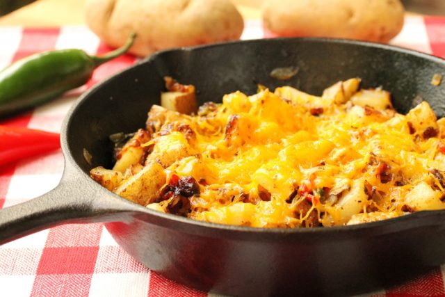 Cheesy Jalapeno Fried Potatoes in iron skillet