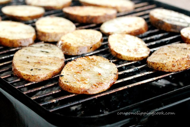 Cook sliced potatoes on barbecue grill