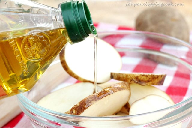 Add olive oil in bowl with sliced potatoes