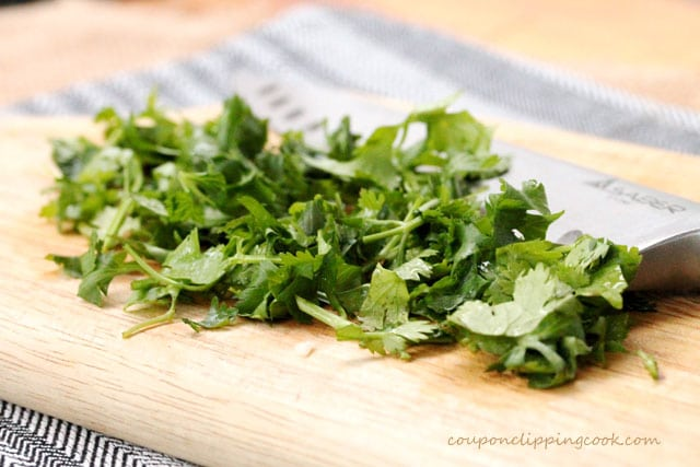 Chopped cilantro on cutting board