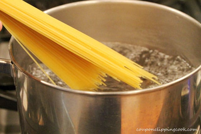 Add spaghetti noodles to boiling water in pot