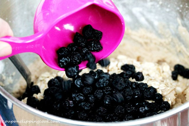Add dried blueberries to mixing bowl