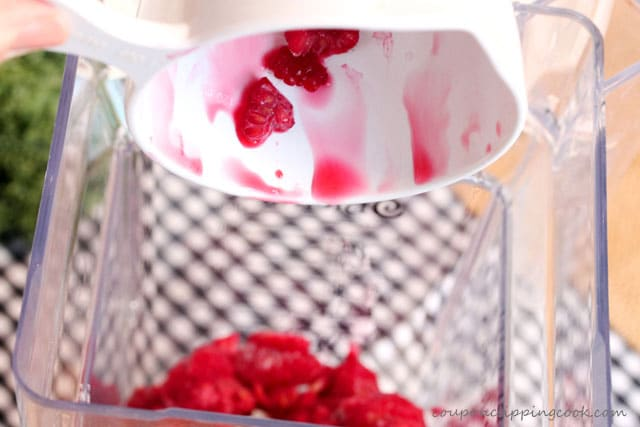 Add raspberries in blender for smoothie