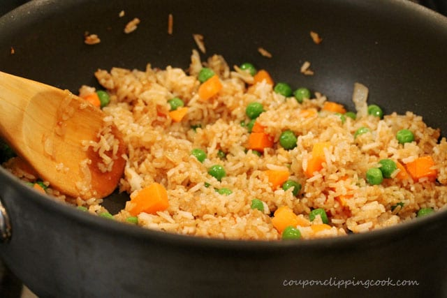 Stir fried rice with vegetables in pan