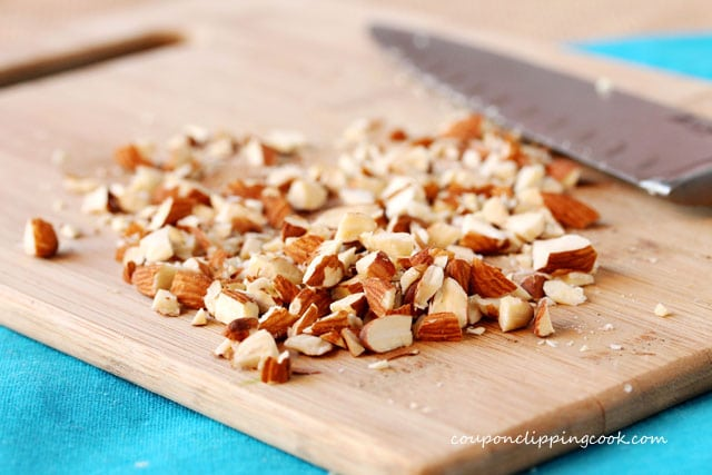 Chopped almonds on cutting board with knife