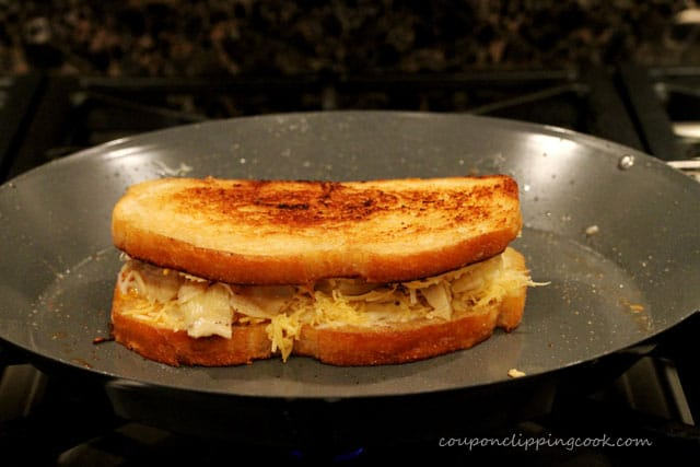 Grilled cheese with artichoke hearts on pan