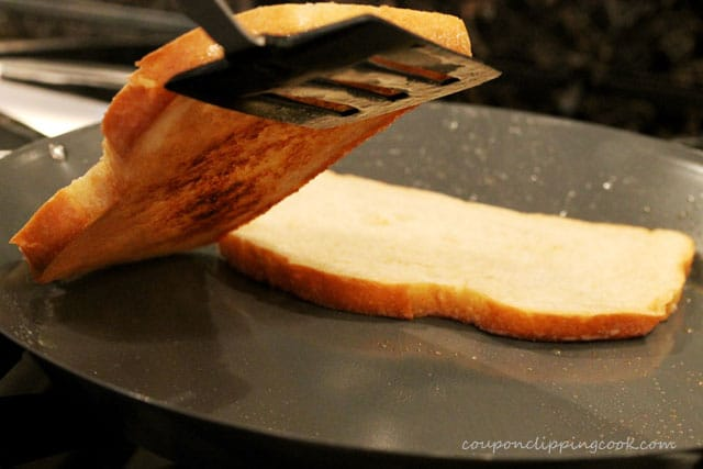Toasted bread slices in skillet with spatula