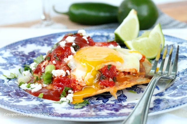 Huevos Rancheros (Egg Tostada) on plate with fork