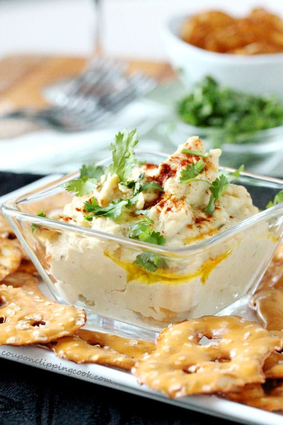 Cilantro Hummus in Bowl with pretzels on plate