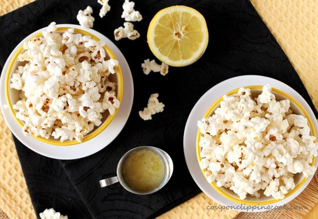 Popcorn in bowls with lemon butter in pitcher