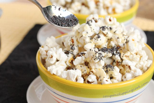 Top lemon butter with poppy seeds on popcorn in bowl