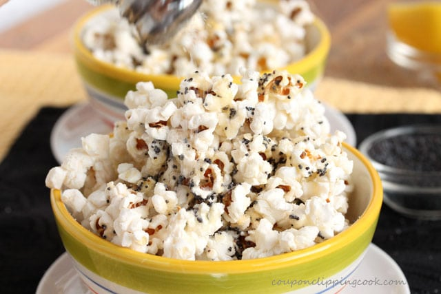 Add salt to Lemon Butter and Poppy Seed Popcorn in bowl