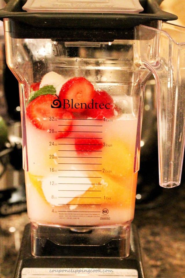 Blend fruit for agua fresca in blender